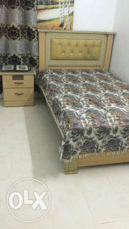 One bed with medicated mattress side table and 6 drawer cupboard