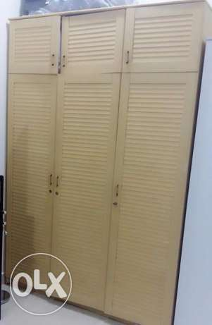 3 door brown Cupboard