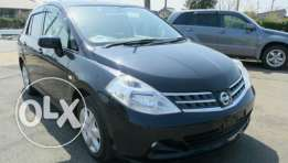Tida 2010 shining black colour  Nissan