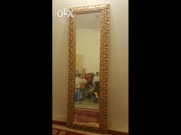 Rectangular vintage mirror with wooden frame.