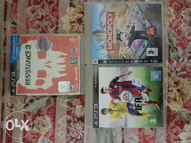 playstation3 ..gear and 3 original games fifa15 resistance and monoply