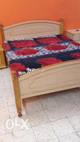Queen size bed with one side table and new madicadet matress