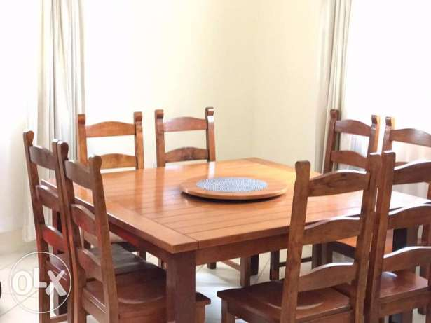 8 Seater Wooden Dining Set 70 BHD