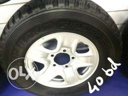 Land cruiser tyre with steel wheel
