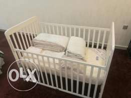 Baby crib with new mattress and blanket
