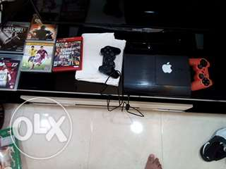 A ps3 for sale with 30 discs and two dualshock