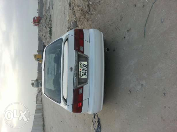 Nissan Sunny 98 model 1 years passing hamad town