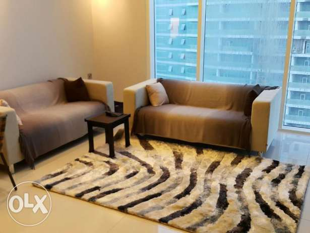 2br (sea view) luxury flat for rent in juffair .