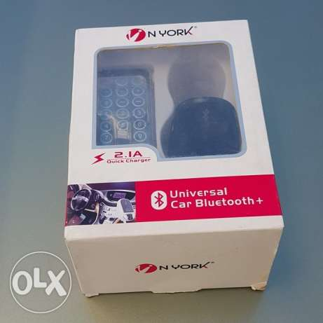For sale Brand new with box Bluetooth FM car kit with Chrging cable