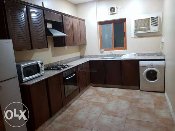 Furnished two-bedroom apartment for rent at Adliya العدلية -  2