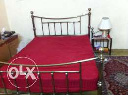 Queen size bed with mattress and night stand in very good condition
