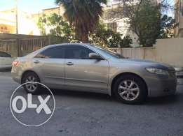 Camry GL 2009 with new shocks, sound system & battery.