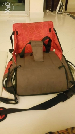 Baby diaper bag with attached seat