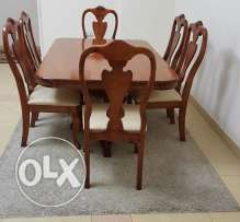 Original Teak wood Dining Table with 6 chairs for sale.