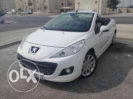 Peugeot convertible 2011 very good condition agents maintenance