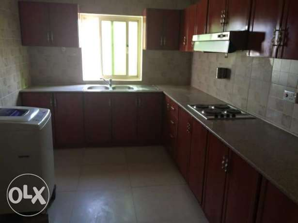 HIDD: 2 Bedroom semi furnished flat with central AC, curtains, cooker