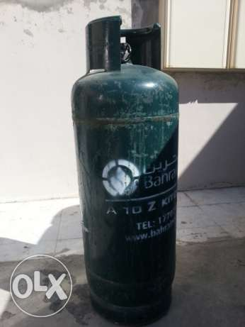Gas Cylinder with full Gas and New Regulator. 34 BD with Delivery.