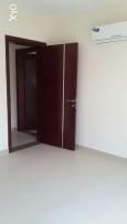 Brand new 2 bedrooms apartment in Hidd. Semi-furnished.