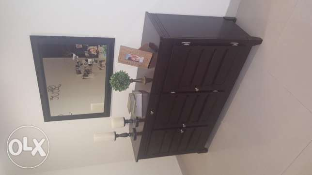 Dining room and cabinet with a mirror