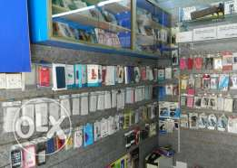 Running mobile shop for sale. in Muharraq good location