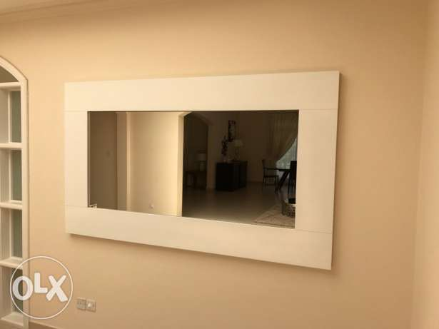 A beautiful large mirror with wooden frame