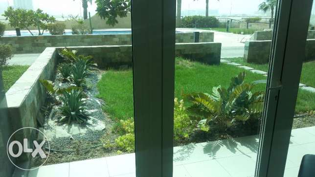 Sea view 2 BR flat in Seef with Private Garden