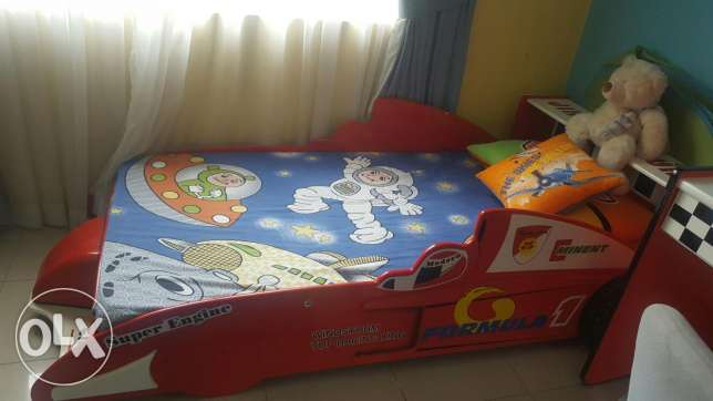 Ferrari car bed with mattress and natching study table for sale