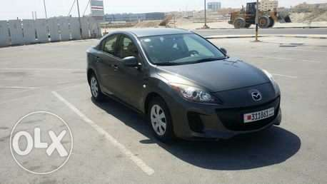 2014 model Mazda 3 for urgent sale. Dealer maintained. Single owner