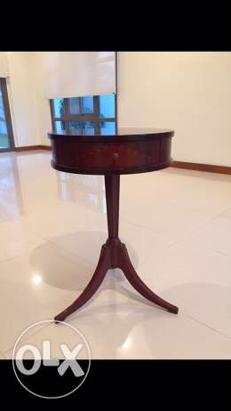 wooden table with three legs