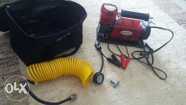 Electric Pressure gage and Tyre air pump never used