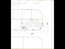 Land for sale in Hidd for ten story building!