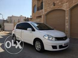 For Sale Nissan Tiida , white color hatchback, 1.8 engine , model 201