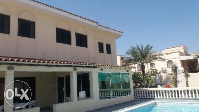 Luxury Villa with pool in Hamad Town ( near Highway )