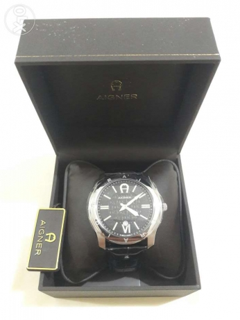 New Aigner original swiss made for men's black belt and black dial. جد علي -  1
