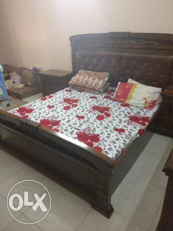 Good quality and strong kingsize bed with side tables