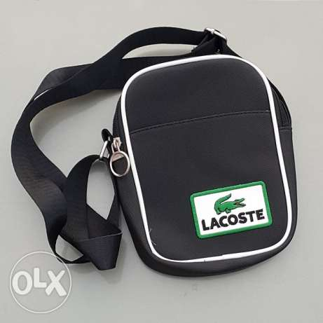 For sale lacoste handbags for man. L. Size new with box