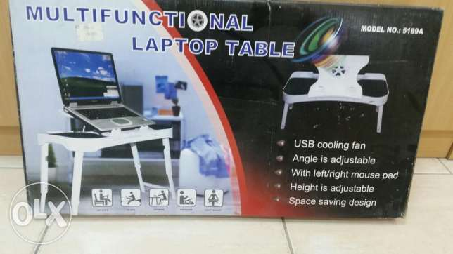 Laptop table with cooling fan and speakers