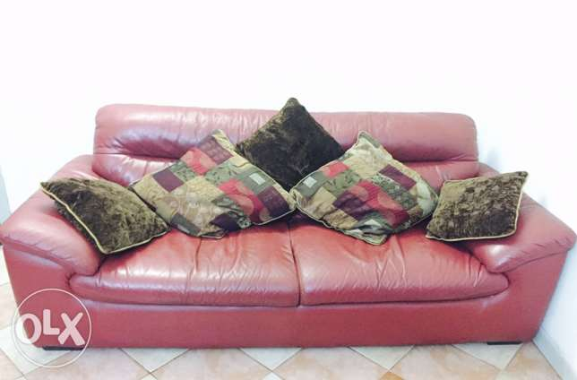 three seated leather sofa (with cushions) 45 BD