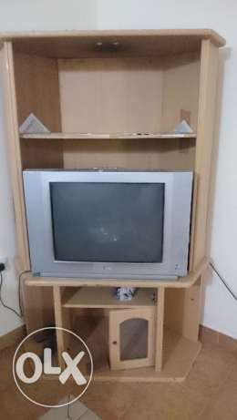 Tv and wooden stand for urgent sale