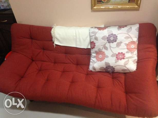 Sofa bed with metal frame
