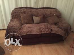 Comfortable brown 2 seater coach