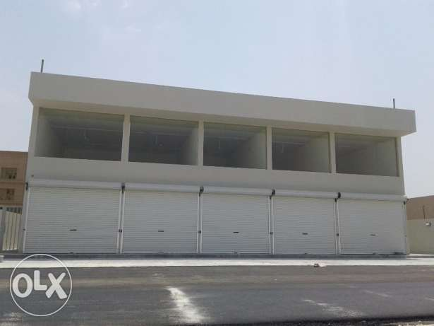 Shop with mezzanine for rent in Busaiteen