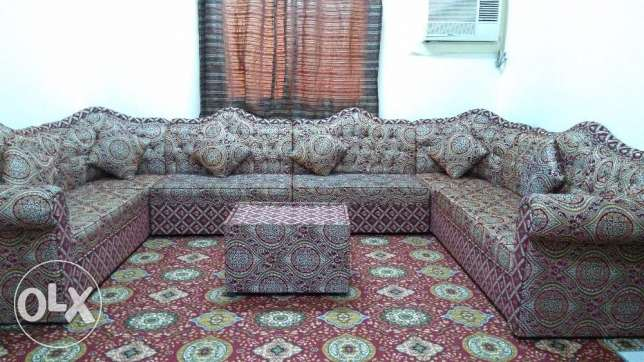 14 seat sofa set dor sale with table and cushions .nice colour ,patter