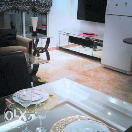 Closed to Saar mall 2 BHK flat with private garden سار -  4