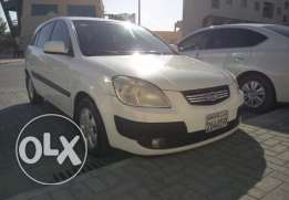 KIA RIO, model july 2006, color white, hatch back small car for BD.950