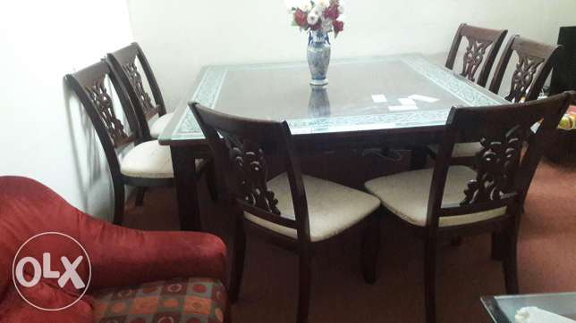 A wooden Dinning table with. 8chairs in good condition