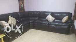Leather corner set with a reclyner for sale