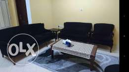 Sofa in a good condition with coffee table and side table