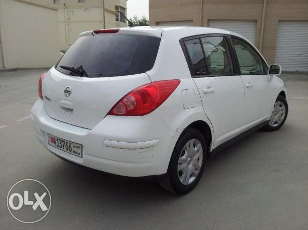Tiida 2012 1.8 hatchback white colour for urgent sale
