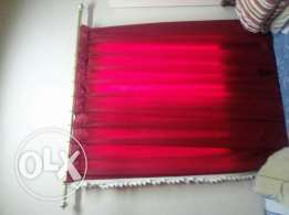 Red curtain with golden holding frame